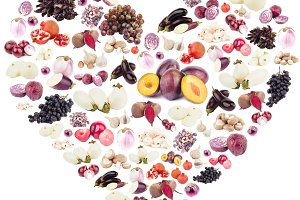 Different violet fruits and vegetables in the shape of the heart, isolated