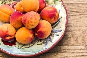 Ripe Apricots on Wooden Table