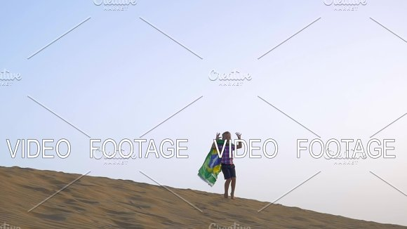 Happy Boy With Flag Of Brazil On The Beach