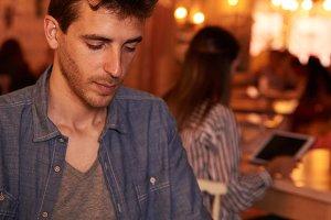 Unshaven millennial sitting