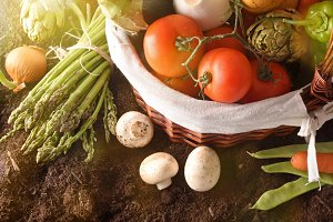 Vegetables in basket on soil topview