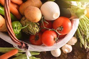 Vegetables in basket on soil top