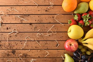 Fruits on wood table aligned right