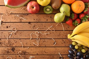 Fruits around a wood table top