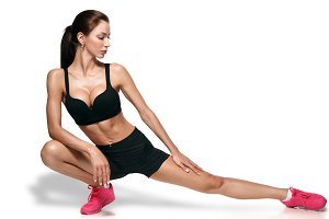 Fit woman stretching isolated over white background