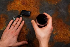 Man holding wine and car key