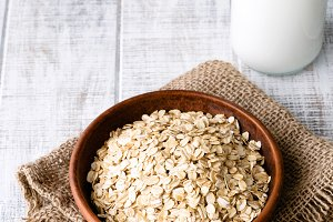 Oat flakes and bottle of milk