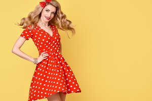 Fashion Beauty.PinUp Girl Smiling.Polka Dots Dress