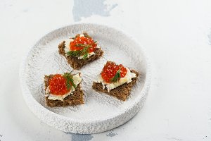 Small canape snacks with red caviar