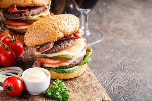 Hamburger and dark beer in vintage style