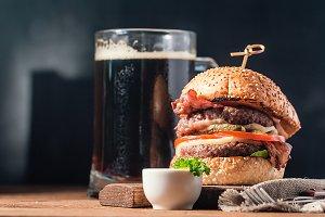 Hamburger and dark beer in vintage style