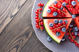 Slice of watermelon pizza cake with berries