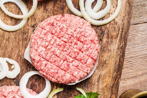Raw burger and spices