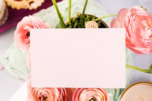 Pink greeting card and flowers