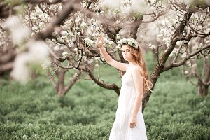 Beautiful girl in orchard