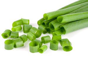 Chopped fresh green onions isolated on white background