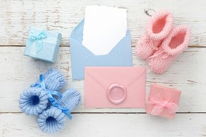 Set of baby girl and boy booties and greeting card form. Top view