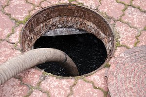 pumping sewage from the drain hole