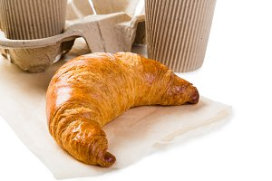 Croissant and coffee to go concept