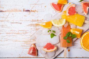 Colorful popsicles on rustic wood background