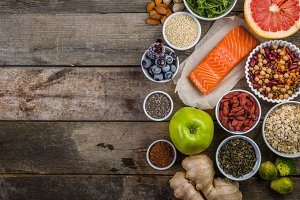 Selection of superfoods on rustic background