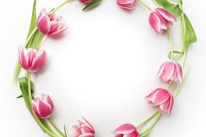 Round frame with tulips flowers. Flat lay. Top view