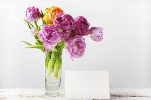 Fresh tulip flowers bouquet and blank with copy space on wooden background