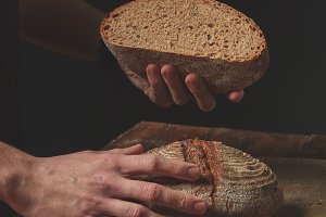 Hands holding half bread