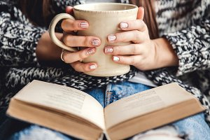 coffee and a book in hand, manicure