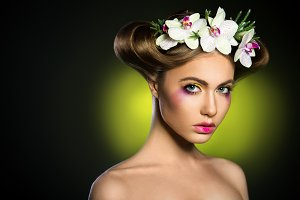 Beautiful woman with orchids flower