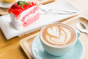 coffee cup and cake on wood table