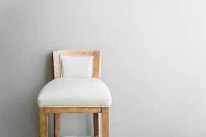 wood chair on gray wall vintage