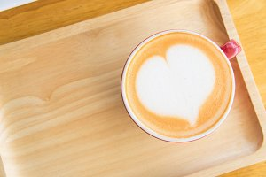 coffee heart cup on wood table