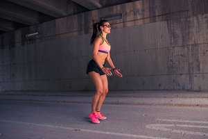 Fit woman warming up outdoors