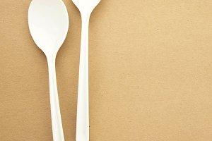 Twin spoon on brown background