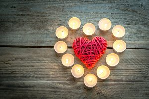 Heart with burning candles