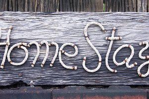 label home stay wooden