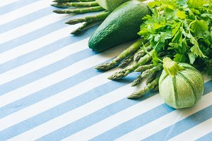 Green vegetables on table cloth