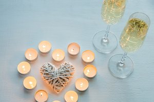 Glasses of champagne with candles