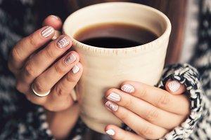 Coffee and stylish manicure