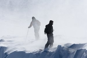 Skiing and snowboarding hard