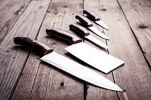 Knives on a wooden background