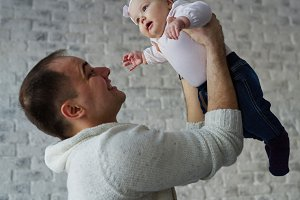 happy father with cute baby