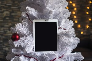 White Ipad on Holiday Christmas Tree