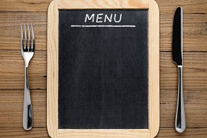 Fork, knife and blackboard menu