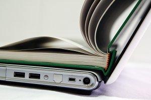 Open book over a laptop