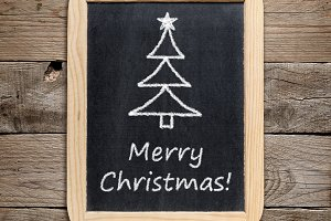 Christmas tree drawing on blackboard