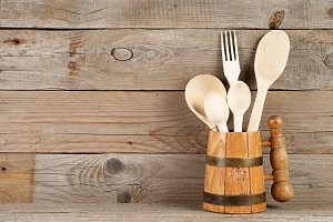 Wooden spoons and fork in mug
