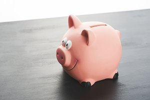 Piggy bank on black table.