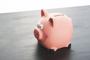 Piggy bank on black table.